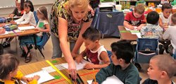 Kindergarten teacher Nancy Armstrong works with her students at Topeka&#39;s Quincy Elementary School.