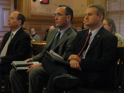 SRS Secretary Robert Siedlecki, right, awaits his appearance Wednesday before the House Appropriations Committee. Hes joined by the departments legislative liaison, Gary Haulmark, center, and  chief of staff, Jeff Kahrs.