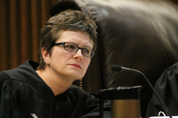 Justice Carol Beier listens during a second round of oral arguments in the case of Miller v. Johnson.