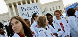 Medical students and professionals show their support for the Affordable Care Act outside the U.S. Supreme Court Building in Washington, D.C. This week, the high court, which has set aside six hours over three days, will hear arguments about the constitutionality of the health reform law.