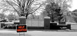 Larned State Hospital has suffered high turnover among employees, many of whom have been asked to work 12- or 16-hour shifts. Efforts to hire additional workers has been stymied by the relatively low pay offered, the rural setting, and the difficult working conditions. (Photo illustration by Cathy McNorton)