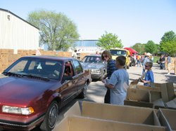 Volunteers distribute food and supplies in the Just Food parking lot in Lawrence.