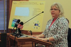 Debra Billingsley, executive director of the Kansas Board of Pharmacy, speaks at a press conference called by the Kansas Department of Health and Environment to announce its new medication disposal program. Revised regulations will allow people to take unused medications to participating pharmacies for disposal.