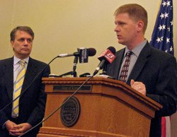 KDADS Secretary Shawn Sullivan at the podium during Monday's press conference about the waiting list for home and community-based Medicaid services for the physically disabled. To his left is Lt. Gov. Jeff Colyer.