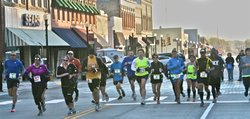 Runners took off from Chanute as part of the inaugural Portland Alley Marathon, which wound through Humboldt and ended in Iola on Nov 3. Organizers hope that the cooperation it took to pull off the race will spill over into other efforts to improve the economy, health and overall quality of life in Kansas' poorest region.