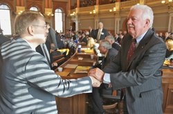 Newly-elected Speaker of the House Ray Merrick, right, is congratulated by Rep. Pete DeGraaf, R-Mulvane. Merrick is a Stilwell Republican. He was chosen in a second round of balloting over Rep. Arlen Siegfreid, R-Olathe.