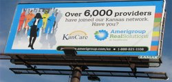 An Amerigroup billboard in Lawrence advertises the number of providers the managed care company has in its network. Some legislators and others say the KanCare transition is going smoother than expected. But others say the jury is still out on the effectiveness of the program's implementation. The state contracted with three managed-care companies. The other two are Sunflower State Health Plan and United Healthcare.