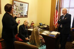 Sen. Ralph Ostmeyer (R-Grinnell) meets with dental hygienist Tammi Engel (left) and Heidi Lowry, director of the Rawlins County Dental Clinic in Atwood. The two were among about 30 hygienists from around the state to meet with their legislators today.